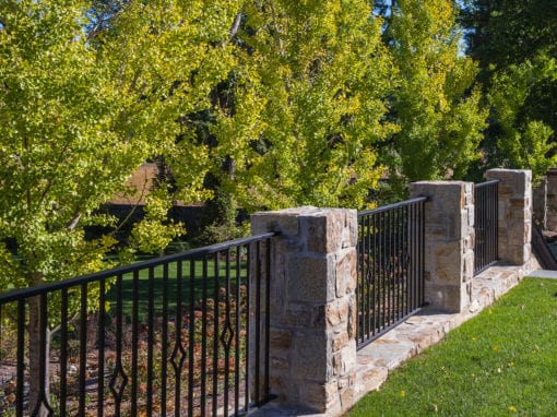 Exterior Steel Fencing with Stone Pillars